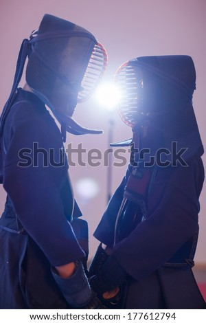 duel of two kendo fighters. Japanese martial art of sword fighting  - stock photo
