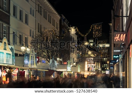 DUESELDORF, GERMANY - NOVEMBER 23, 2016: Unidentified indivuduals strolling through the illuminated lanes of the Altstadt