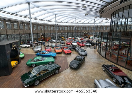 DUESSELDORF, GERMANY - AUGUST 08: Collectors cars in the Classic Remise Duesseldorf, a center for vintage cars. It can be found in a historic roundhouse for locomotives.