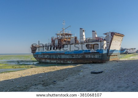 Duha, Kuwait - February 13, 2016: An old broken ship parked in duha port Kuwait.