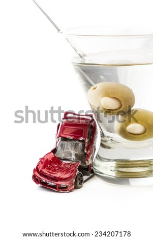 DUI concept. Image of a drunk driving accident with a vodka martini  isolated on a white background - stock photo