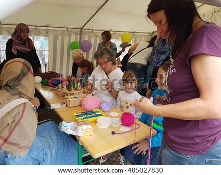 DUISBURG, GERMANY - 18.09.2016 Children's World day. Children participate in games, sweepstakes, learn new things, or just play to get gifts, sweets & souvenirs. Parents and adults help young people.