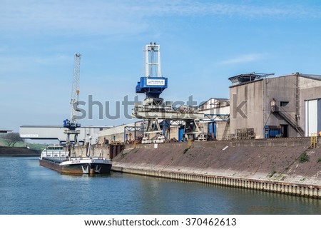 DUISBURG / GERMANY - JANUARY 25 2016 : Bulk terminal in the harbour at work