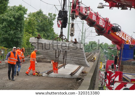 DUISBURG, GERMANY - 19 September 2015 Construction site of the railway in the city with a using vehicles, equipment and humans