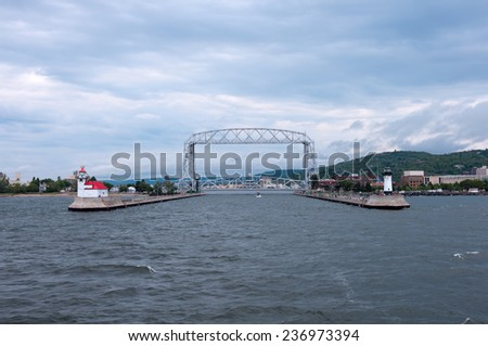 DULUTH, MN/USA - AUGUST 31, 2014: Aerial Lift Bridge, a Duluth landmark, is the entry point to the Duluth Canal and marks the westernmost point of the Great Lakes Waterway and Saint Lawrence Seaway. - stock photo