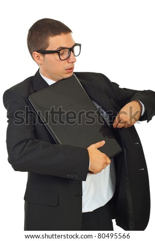 Dumb business man trying to put laptop in interior of jacket suit isolated on white background - stock photo