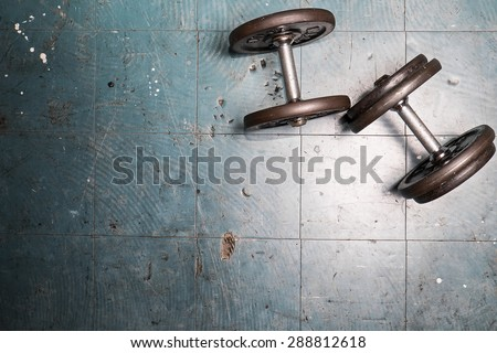 dumbbell exercise weights on the floor - stock photo