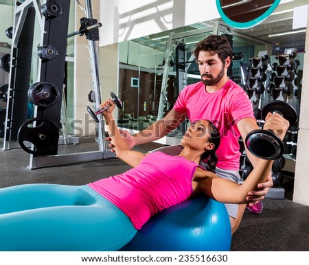 Dumbbell fit ball fly chest flies opening arms workout and personal trainer at gym - stock photo