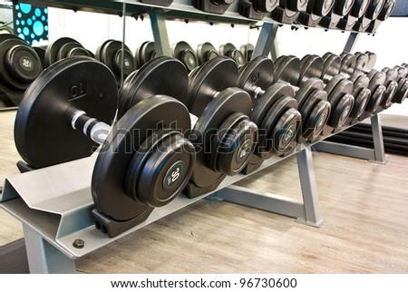 dumbbell in fitness room - stock photo