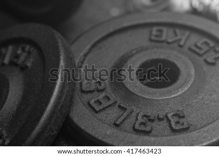 dumbbell iron plates black and white