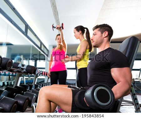 Dumbbell man at gym workout fitness weightlifting and dumbbell women personal trainer - stock photo