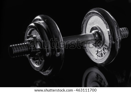 dumbbell on black background