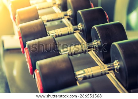 Dumbbell selective focus point - vintage filter and sun flare effect
