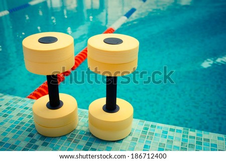 Dumbbells for Aqua Aerobics - stock photo