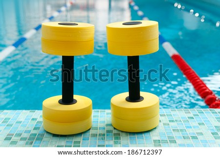 Dumbbells for Aqua Aerobics inthe pool