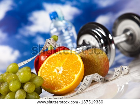 Dumbbells, fresh food and measure tape