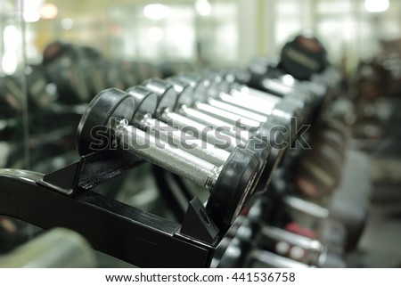 Dumbbells in gym.