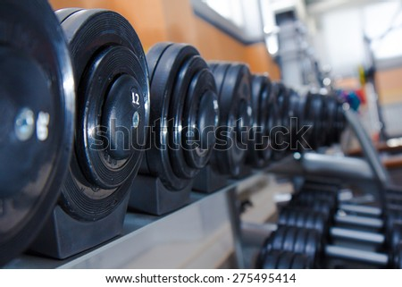 dumbbells in the gym - stock photo