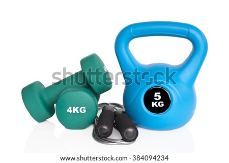 Dumbbells, kettlebell and skipping rope isolated on white background. Weights for a fitness training. - stock photo