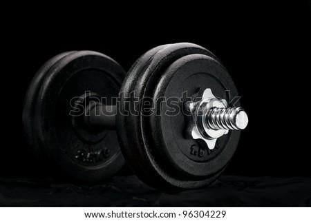 dumbbells on a black background - stock photo