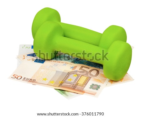 Dumbbells on heap of euro isolated on a white background - stock photo