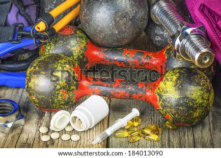 Dumbbells, sports gear with pills and medicines - stock photo