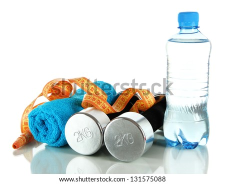 Dumbbells with centimeter,towel and bottle of water isolated on white - stock photo