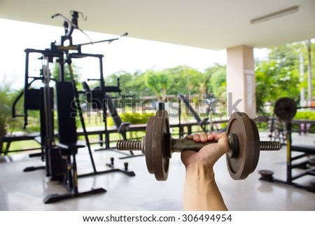 Dumbell with blur fitness gymt background - stock photo