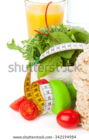 Dumbells, tape measure and healthy food. Fitness and health. Isolated on white background