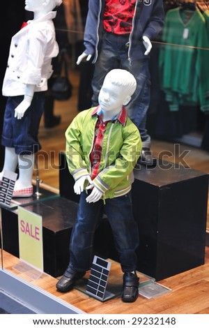 Dummy in the clothing store. No brandnames or copyright objects. - stock photo