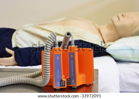 Dummy with defibrillator - stock photo