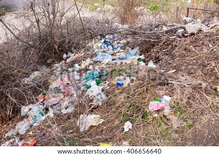 dump garbage on the street as a background - stock photo