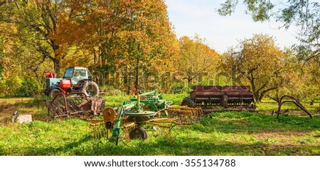 Dump of the old agricultural machinery - stock photo