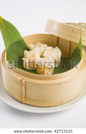 Dumplings in bamboo steamer - stock photo