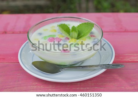 Dumplings in coconut cream (Bua Loi) on wood background, Dessert of Thailand.