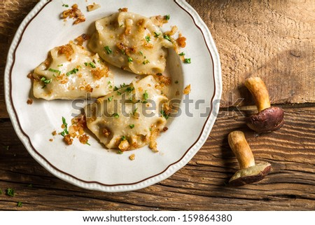Dumplings made with mushrooms, onions and parsley - stock photo