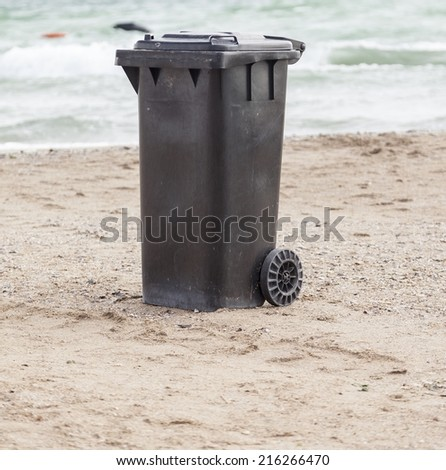 Dumpster on a beach - stock photo