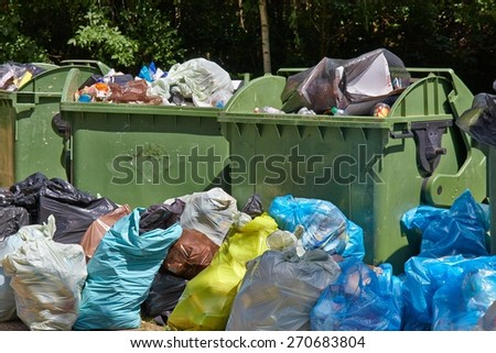 Dumpsters being full with garbage - stock photo