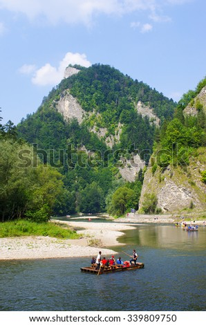 DUNAJEC RIVER, POLAND - AUGUST 11, 2015: traditional boat during the rafting. It is one of oldest and most famous entertainments in Poland. - stock photo