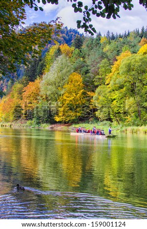 DUNAJEC RIVER, POLAND - SEPTEMBER 20: Tourists raft on September 20, 2013 on the Dunajec river, south of Poland. The rafting near the slovakian border is very popular tourist attraction.