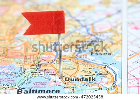 Dundalk, Maryland. Red flag pin on an old map showing travel destination.