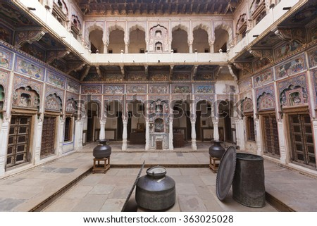 DUNDLOD, RAJASTHAN, INDIA - FEBRUARY 21, 2012: A beautiful frescoed Haveli pictured in the Shekhawati region of India on February 21, 2012. Havelis are traditional ornately decorated residences. - stock photo