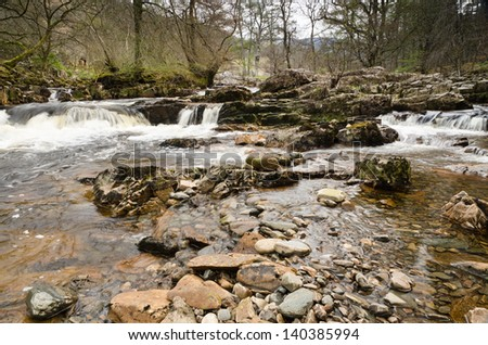 Dundonnell River / River Dundonnell cascading over rocks in the Scottish highlands - stock photo