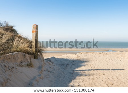 Dune, beach and sea in the Netherlands on a sunny day in spring. - stock photo