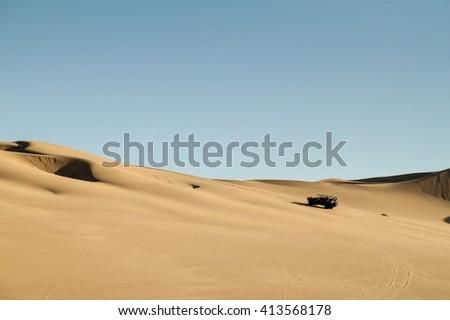 Dune buggy rides the sand dunes in Huacachina desert, Peru - stock photo