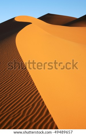 Dune edge is sea of sand - stock photo