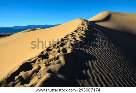 Dune Peak with Footprints at Death Valley - stock photo