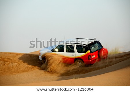Dune riding in desert outside of Dubai - stock photo