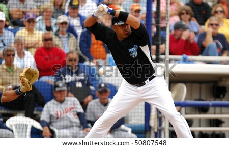 DUNEDIN, FL - MARCH 22: Toronto Blue Jays outfielder Vernon Wells avoids an inside pitch in the spring training game on March 22, 2010 in Dunedin, FL