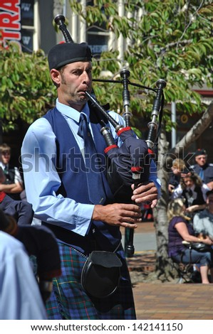 DUNEDIN, NEW ZEALAND, FEBRUARY 21: A pipe band member performs in a competition in the Octagon on February 21, 2010 in Dunedin, New Zealand